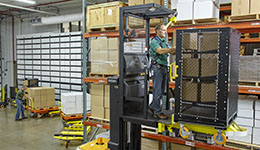 Man on crown stand up forklift.
